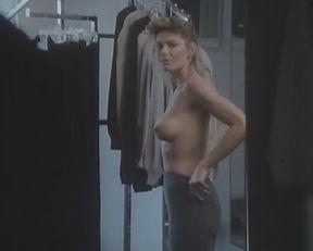 Tara Buckman nude – Blue Angel Cafe (1989)