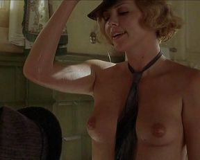 Charlize Theron nude – Head in the Clouds (2004)